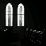 Stained glass windows and pew